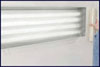 """RBL Products, Inc. 24"""" x 100' Continuous Roll Self-adhering Clear Plastic Film - Perforated Every 24"""" Along Length"""